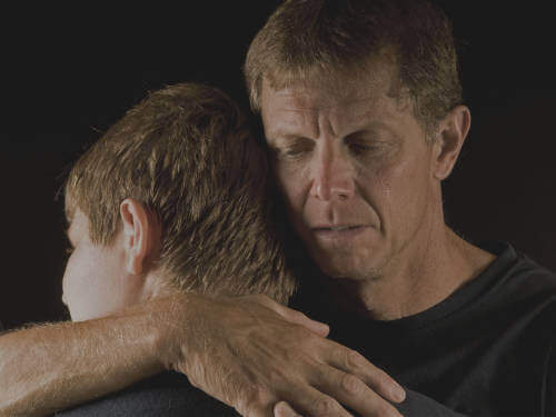 CAMHS professionals' feedback on the EarlyYES attachment training, illustrated by a father comforting his son